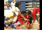 Courtesy photo - Cove's Oni Boodoo, left, fights for a loose ball during the Lady Dawgs 66-55 win over Crosby as part of the 2016 Aggieland Invitational Tournament. The Lady Dawgs finished fourth out of 30 teams in the field with a 3-2 tournament record.