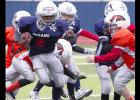 CCLP/TJ MAXWELL - Texans running back Josiah Wilson splits some Broncos defenders in the fourth quater of their 22-12 win in the Copperas Cove Youth Football League Division I championship held Saturday at Bulldawg Stadium. Wilson scored on touchdown runs of 68, two and six yards.