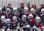 CCLP/TJ MAXWELL - The Texans hold up their championship rings after defeating the Broncos 22-12 in the CCYFL Division I Championship Saturday at Bulldawg Stadium. The Texans rallied from a 2-6 regular season to win the championship..