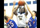 CCLP/LEE LETZER - Copperas Cove senior Chyanne Chapman (54) shoots between San Angelo defenders Sydnie Gilbert (25) and Morgan Walker during the Lady Dawgs 57-48 win Friday at Bulldawg Gymnasium. Chapman registered a doubledouble with 10 points and 10 rebounds in the win.