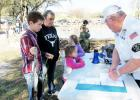 CCLP/BRITTANY FHOLER - Karen Sutton waits with her grandchildren Matthew Thompson, 12, Stormie Wilson, 4, and Isabelle Wilson, 6, to receive their certificates of honorary membership of the Copperas Cove Bass Club for catching their fish at the 10th annual Fishing in the Park event held Saturday morning.