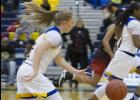 CCLP/TJ MAXWELL - Cove sophomore Madison Griffon drives during the Lady Dawgs' 70-38 win over Manor on Friday.