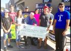 Courtesy Photo - The Copperas Cove High School Excel Club along with the HUTS Excel Club collected more than 1,200 pounds of non-perishable food items and $700 in donations at Wal-Mart on Saturday as part of the two clubs' Make A Difference Day service project.