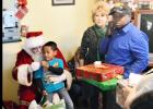 CCLP/LYNETTE SOWELL - On Thursday, the Copperas Cove Soup Kitchen was the setting of a visit from Santa Claus along with a gift distribution to local children in need. More than 60 children were given gifts this year via the gift drive headed up by soup kitchen director, Patrick Richardson.