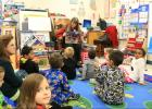 Courtesy Photo CCISD - Benefits Specialist Shirley Bennett reads to students at Mae Stevens Early Learning Academy in conjunction with International Literacy Day. The school used a round robin strategy as students changed classes listening to a variety of guests read aloud books related to the Christmas holiday.