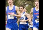 "CCLP/TJ MAXWELL - Cove senior William ""Chase"" Thomas, center, chases after Midway's Ryan Day and Peter Ferretter, right, during the District 8-6A Cross Country Meet in Waco. Thomas finished fifth to qualify individually and lead his team a third-place finish."
