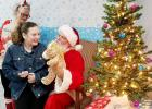 CCLP/DAVID MORRIS - Alyssa Morris visits with Santa after making a stuffed giraffe at Bearables Sunday.