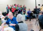 CCLP/BRITTANY FHOLER - Senior citizens of Copperas Cove eat and enjoy entertainment by the Sunrise Singers from Williams-Ledger Elementary School at the annual Christmas senior dinner hosted by the Copperas Cove Exchange Club at the Copperas Cove Civic Center Sunday afternoon.