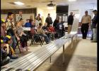 CCLP/PAMELA GRANT - Scouts and their families watch as their colorful wooden racecars zoom down the tracks during Saturday's Pinewood Derby for Cub Scout Pack 251.