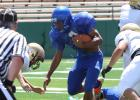Copperas Cove junior runningback Antonio Lealiiee splits a pair of Abilene defenders on his way to the end zone during the controlled portion of their scrimmage Friday at Shotwell Stadium in Abilene.