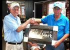 "CCLP/TJ MAXWELL - Buck Wilkins, right, is presented with the Ledger Furniture donated golf plaque ""Born to Golf/Forced to Work' by Cove Bass Club secretary Jack Johnson"