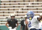 CCLP/TJ MAXWELL - Cove senior quarterback Caine Garner makes a throw during the Dawgs's scrimmage against Abilene on Aug. 19