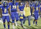 File Photos - Connor Hedger walks on the field last season with the Bulldawgs for a special presentation during a home game.