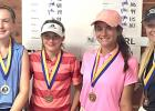COURTESY PHOTO - Cove's Madelyn Miller, right, poses after winning the Beltway Junior Tour event at the Hills at Cove Golf Course on Wednesday. Miller, who is new to the sport of golf. posted a score of 99 to win her division.