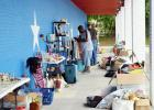 CCLP/LYNETTE SOWELL Customers check out the variety of items at a storage unit sale, held by Armadillo Properties. The real estate management company is donating the sales from the two-day event to Cove House Emergency Homeless Shelter.