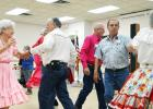 File photo - Dancers take to the floor at the Double C's square dance club 45th anniversary party in April. The club is holding two open houses, on Sept. 13 and 20, with their fall classes to begin Sept. 27.