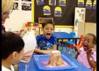 CCISD/Brandy Petty - Three- and 4-year-olds Ezekiel Garcia, Lashia Jones and Asher Diaz scream with excitement as they watch a volcano they built erupt in their classroom. The project met several pre-K learning guidelines in science as well as life skills.
