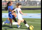 CCLP/TJ MAXWELL - Cove junior Nicole Evans takes a shot on goal in the first half of the Lady Dawgs' 1-0 playoff loss to Duncanville.