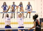 CCLP/TJ MAXWELL -- Copperas Cove juniors Chyanne Chapman (13) and Brianna Acker (17) combine for a block on the shot of Harker Heights senior Kennedi Foster during their 3-1 win on Tuesday.