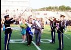 CCISD/Courtesy Photo - The Copperas Cove High School JROTC Saber Team uses its sabers to form an arch under which the newly crowned homecoming queen and king, Skye Richard and Juston Case, pass. The saber arch is a military tradition typically used to introduce a new couple to the community.