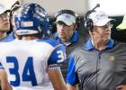 CCLP/TJ MAXWELL - Copperas Cove head coach Jack Welch, second from right, will lead his team into battle in the regular season finale against Belton. The Dawgs must beat Belton to make playoffs for 13th-consecutive year.