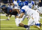 CCLP/STEVEN DOLL - Cove senior defensive tackle James Vernardos sacks Garland Sachse quarterback Jalen Mayden during the Dawgs' 48-16 loss. The Dawgs' defense will need to slow down the Midway Panthers' powerful offense to come away wth a win.