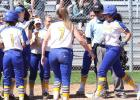 CCLP/TJ MAXWELL - Copperas Cove sophomore Jayda Carter is welcomed home by teammates after connecting on a game-tying solo home run in the first inning of the Lady Dawgs' 10-3 win over the Lady Wolves Wednesday at Copperas Cove High School. The Lady Dawgs (12-6-1, 4-1 in District 8-6A) return to action with a road game against Killeen tonight.
