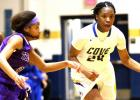 Copperas Cove senior Kenya Haynes streaks past a pair of University defenders in their 64-24 win over the Lady Trojans on Monday.