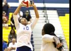 CCLP/TJ MAXWELL - Cove senior setter Kiarrah Carlisle sets as senior Chyanne Chapman loads for a kill attempt during the sweep of Ellison.