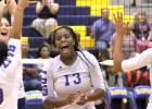 CCLP/TJ MAXWELL - Lady Dawgs, from left, Kiarraj Carlisle (10), Brinna Acker, Chyanne Chapman and Aidan Chace celebrate a Chapman block that ended their five-set match against Liberty Hill on Tuesday. The Lady Dawgs won (26-28, 21-25, 25-17, 25-19, 15-9).