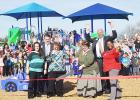 COURTESY PHOTO - Mae Stevens Early Learning Academy principal Mary Derrick cuts the ribbon on the school's new playground surrounded by school staff and CCISD superintendent Joe Burns and deputy superintendent Rick Kirkpatrick.