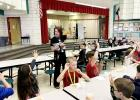COURTESY PHOTO - Williams/Ledger Elementary principal Marla Sullivan asks students how many of them will make straight A's on their report cards the next six weeks so they can attend Sweets with Sullivan. All 40 students in attendance raised their hands.