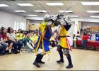 CCLP/LYNETTE SOWELL - Members of the Society for Creative Anachronism perform an armored combat demonstration at Wednesday morning's summer reading program kickoff.