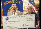 CCLP/DAVID MORRIS - Noon Exchange Club President Dennis Ayres, right, presents Judge John Firth a check for the Coryell County Child Welfare Board.
