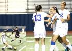 CCLP/TJ MAXWELL - INSET: Copperas Cove junior Nicole Evans makes a cross to sophomore Mariah Ruiz during the first half of the Lady Dawgs' playoff-clinching 1-0 win over Killeen Friday night at Bulldawg Stadium. ABOVE: Freshman Haven Stevenson celebrates with teammates Kailey Walker (13) and senior Jordan Campbell after she scored with a header on a cross from Evans in the 37th minute.