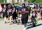 CCLP/PAMELA GRANT - Participants in Team J. Lyons' Walk For Lupus start their 5k run on Saturday at Ogletree Gap Park.