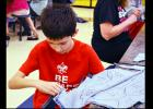 CCLP/DAVID J. HARDIN - Sixth Grader Matthew Petty helps cut jeans at Sole Hope cutting party held last Saturday at the Copperas Cove High School.