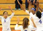 Sophomores, from left, Aviyon Wilborn (5), Aidan Chace and Jada Close,along with senior Dazsa Braddock, celebrate a block by Close.