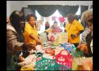 CCLP/LYNETTE SOWELL - Volunteers from the Women's Army Corps Veterans Association sort through baby items as they make baskets for mothers-to-be at the Hope Pregnancy Center.