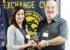 "President Dennis Ayres presented Kelly Dalrymple the ""Exchangite of the Quarter"". Dalrymple was awarded the plaque for her dedication in promoting the work of the Exchange Club."