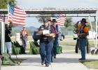 Greg Todd leads the procession as he delivers one of six unclaimed veterans to their final resting place, Wednesday at the Central Texas State Veterans Cemetery.
