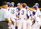 Copperas Cove senior Michael Sizemore, center, along with other teammates, congratulate senior Kyle Winstead (15) after connecting for a walk-off double to give the Bulldawgs a 10-0 victory over Temple on Tuesday.