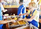 April Fitzgerald serves up eggs at Saturday's flapjack fundraiser held by the Rotary
