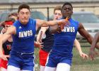 Copperas Cove dual-sport athlete Andrew Leuthner gets the hand off from teammate Justin Joe during 4x100- meter relay as part of the Eagle Relays in March.