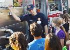 Matthew Musick with the Copperas Cove Fire Department tells fifth graders about the workings of Engine 2 at Friday's Fire Prevention program at Halstead Elementary.