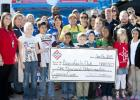 Representatives from the Copperas Cove Boys and Girls Club accept a $1,000 donation from Stripes Convenience Store during the grand opening celebration Friday.