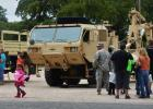 Families look at vehicles on display from the First Cavalry's 115th Brigade Support Battalion, 1st Brigade Combat Team during the annual Spurfest celebration in Gatesville.