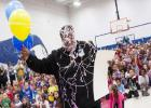 Ernest Sapp is coated in silly string as he accepts his grant monies from the Education Foundation Thursday morning. Sapp is an instructor at Fairview/Jewell and is one of 16 educators from the campus to receive a grant.