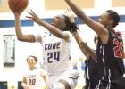 Copperas Cove senior Kenya Haynes streaks to the basket in front of a pair of Lady Knights' defenders during their 72-62 win on Friday. Haynes was one of five Lady Dawgs to score in double-digits.