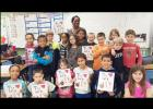Third grade students in Denise Carmichael's class at House Creek Elementary School show off their newly published books containing their opinions of bullying. Students were involved in the entire writing process to prepare and create the book including brainstorming a topic as a class and outlining the story elements of the book.